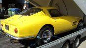 Ferrari in car transport pod